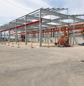 L'ampliamento di una nuova area a sud del fabbricato industriale delle Officine di Cartigliano Spa